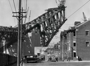 Emil Otto Hoppé: The Sydney Harbour Bridge Under Construction, Sydney from North Sydney, 1930 (© 2017 Curatorial Assistance, Inc./E. O. Hoppé Estate Collection)